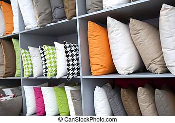 Cushions - Various cushions on wooden shelves