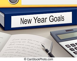 new year goals binders isolated on the office table