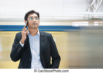 Talking on phone at train station