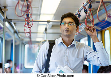 Indian businessman inside train - Asian Indian businessman...