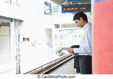 Indian business man waiting train - Candid Asian Indian...