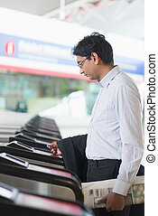 Indian businessman at entrance of railway station - Asian...