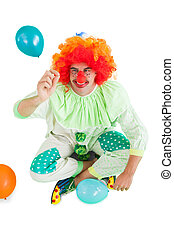Funny clown holding hand up on white background