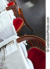 Bistro - Table set up and chairs in a French bistro