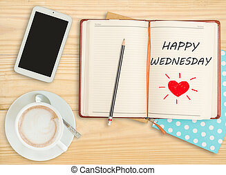 """Happy Wednesday""on notebook with smart phone and coffee cup..."
