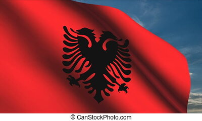 Albanian Flag waving in wind with clouds in background