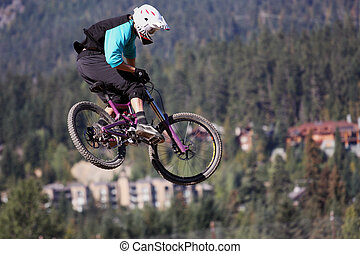 Xtreme Bike Jump - A hardcore mountain biker captured...