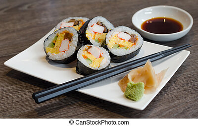 Sushi roll with ginger and wasabi
