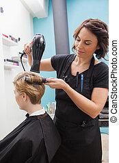 Hairdresser drying a customers hair