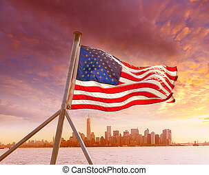 Manhattan skyline New York with American flag US USA