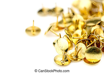 Macro of golden thumb tacks background