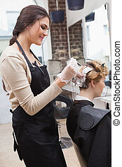 Customer getting her hair coloured in hairdressers