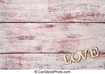 love letters carved on the old wooden background
