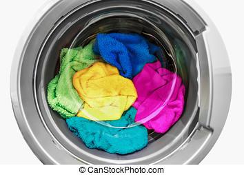 washing machine - colorful clothes in the washing machine...