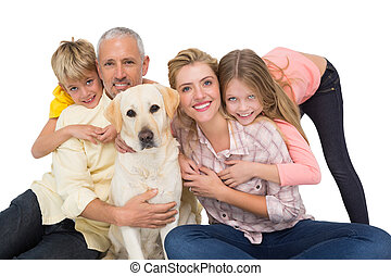 Happy family with their pet dog  on white background