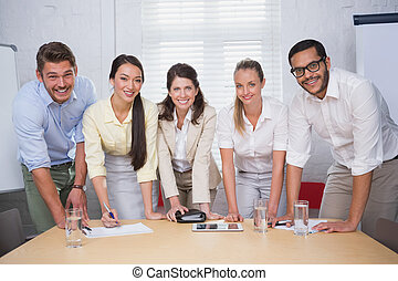 Smiling business people working together on a document