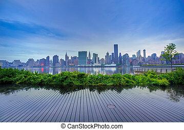 Manhattan New York skyline at sunset East River - Manhattan...