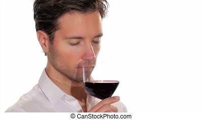 young man enjoying a glass of wine - portrait of handsome...