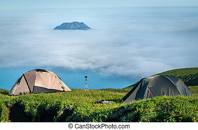 Fuss PeTourist tents in the mountains, Paramushir Island,...