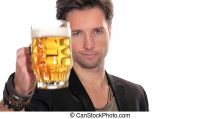 young man drinking beer - portrait of handsome man drinking...