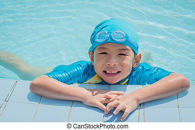 Happy Asian boy in swimming pool