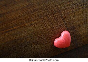 Red heart on wooden background for valentines day or...