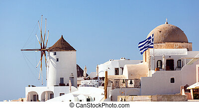Windmill in Oia, Santorini. Oia is a village in the north...