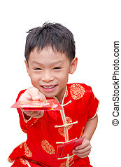 Asian boy with Chinese traditional dress giving ang pow or...