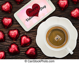 """""""I love you"""" on smart phone screen with coffee and chocolate"""