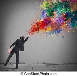 Colors with a spray - Young and creative businessman colors...