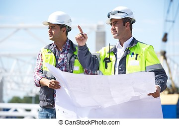 Civil Engineers At Construction Site - Civil engineer at...
