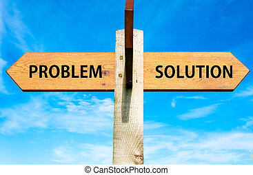 Wooden signpost with two opposite arrows over clear blue sky, Problem versus Solution messages, Problems solving conceptual image