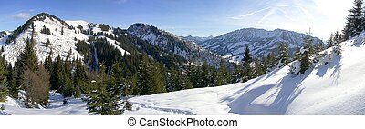 Winterworld in the bavarian alps - Snow-covered footpath in...