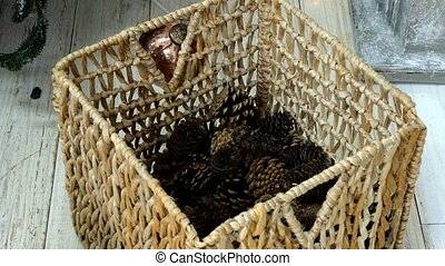 Cones collecting to wattled basket