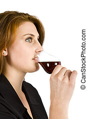 Drinking Red Wine - Beautiful young woman drinking red wine...