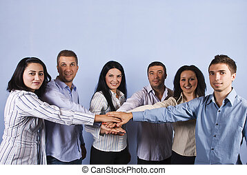 United group of business people with hands together - United...