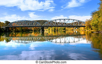 Autumn landscape - Reflections of beautiful bridge and...