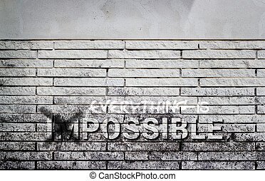 impossible text on gray brick wall