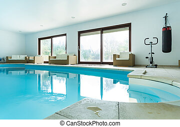 Swimming pool inside expensive house - View of swimming pool...