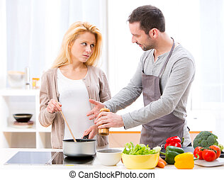 Young attractive couple having an argue while cooking - View...