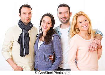 Group of 4 young attractive people on a white background -...