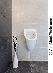 Urinal in modern bathroom - Vertical view of urinal in...