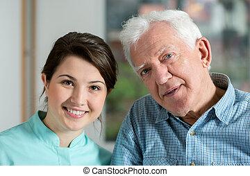 Portrait of nurse with patient
