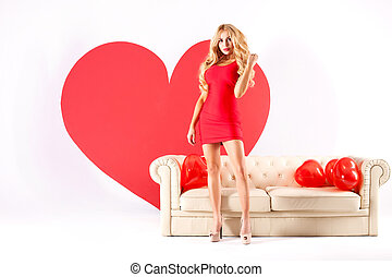 Sexy blonde woman with big heart. - Sexy blonde woman in red...