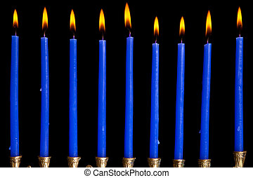 hanukkah candles on black background - burning hanukkah...