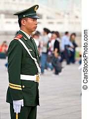 Chinese Royal palace guard in Tiananmen Square, Beijing -...