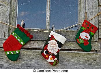 Homecoming Christmas - Holiday socks hanging on baling twine...