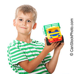 Boy with a toy - Boy holding car isolated on white...