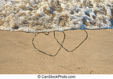hearts on the seashore - Pair of hearts in beach sand with...