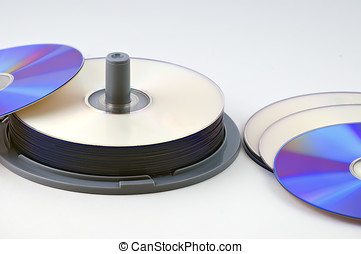 CD-R data discs in a stack with several laid out on the desk